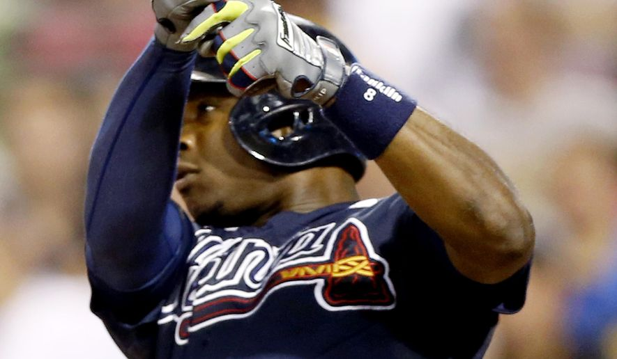 Atlanta Braves' Justin Upton holds the bat after breaking it hitting a single to drive in two runs in the fifth inning of the baseball game against the Pittsburgh Pirates on Tuesday, Aug. 19, 2014, in Pittsburgh. (AP Photo/Keith Srakocic)
