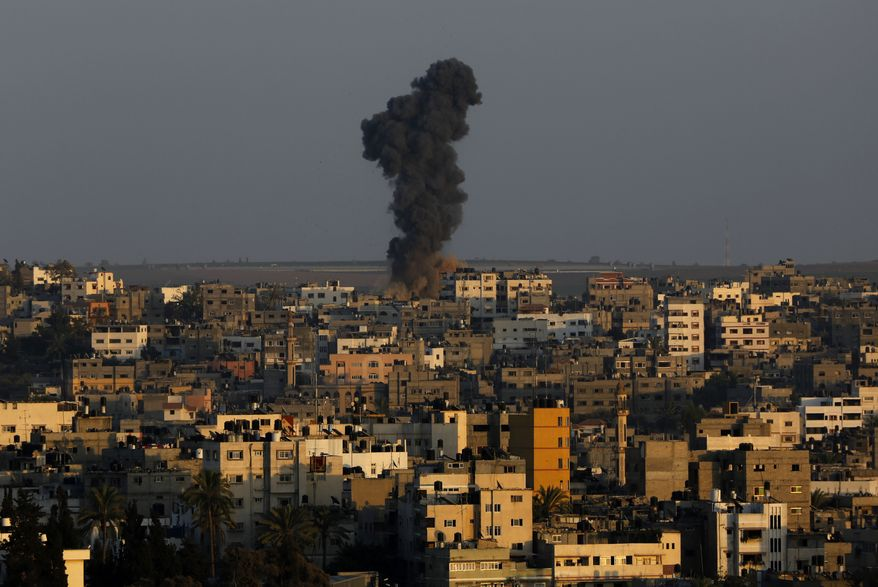 Smoke and dust rise after an Israeli strike hit Gaza City in the northern Gaza Strip, Tuesday, Aug. 19, 2014. (AP Photo/Adel Hana) ** FILE **