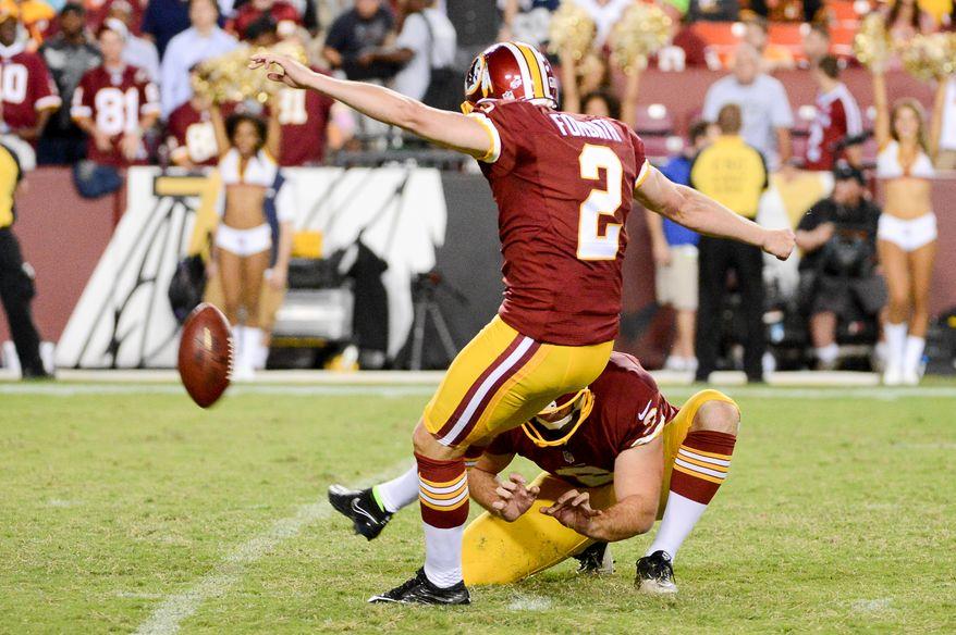 Washington Redskins kicker Kai Forbath (2) kicks a field goal as the Washington Redskins play the Cleveland Browns in NFL preseason football at FedExField, Landover, Md., Monday, August 18, 2014. (Andrew Harnik/The Washington Times)