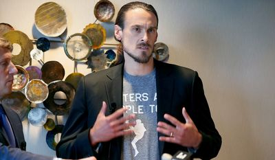 FILE - In this July 15, 2014, file photo, former Minnesota Vikings punter Chris Kluwe, right, speaks during a press conference in Minneapolis. Kluwe says he's reached a settlement with the team to avert a threatened lawsuit over his release. Kluwe had accused the Vikings of cutting him over his activism on gay rights issues. He said Tuesday, Aug. 19, 2014, that the Vikings have agreed to donate to several nonprofits to help raise awareness in professional sports about LGBT issues. (AP Photo/The Star Tribune, Elizabeth Flores, File )