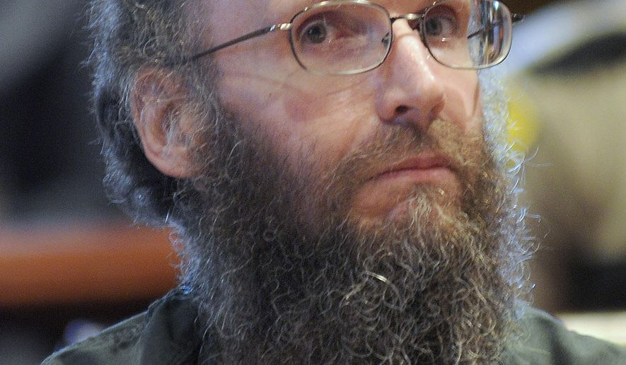 FILE - In this Oct. 28, 2013, file photo, Christopher Knight, known as the North Pond Hermit, sits in the Kennebec County Superior Court in Augusta, Maine. Knight, who lived nearly three decades in the Maine woods now has a job and is adjusting to life back in society, Wednesday, Aug. 20, 2014. (AP Photo/The Kennebec Journal, Andy Molloy, File)