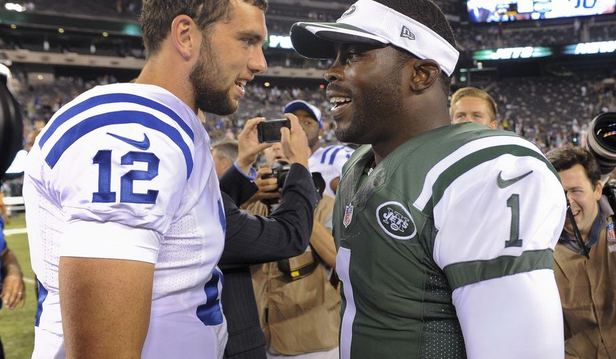 FILE - In this Aug. 8, 2014, file photo, Indianapolis Colts quarterback Andrew Luck (12) greets New York Jets quarterback Michael Vick (1) after the Jets beat the Colts 13-10 in a preseason NFL football game in East Rutherford, N.J. (AP Photo/Bill Kostroun)