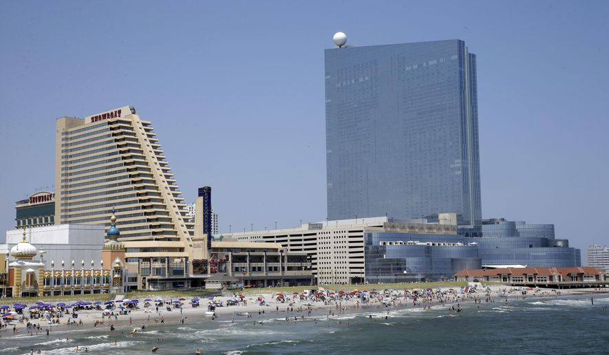 This Wednesday, July 23, 2014 photo shows the Showboat Casino Hotel, left, and the Revel Casino Hotel along the Boardwalk in Atlantic City, N.J. The state Gaming Enforcement Division gave final approval to Revel's shutdown on Sept. 1 and 2, signing the order on Tuesday night and releasing it on Wednesday, Aug. 20, 2014. Showboat and Revel are due to close over Labor Day weekend, with Trump Plaza shutting down on Sept. 16. The shutdowns are part of a rapid unraveling of Atlantic City's gambling market, which began the year with 12 casinos, but will have eight before summer ends. (AP Photo/Mel Evans)