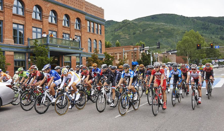 Riders leave Aspen, Colo., en route to Crested Butte, Colo., on Tuesday, Aug. 19, 2014, during the second stage of teh USA Pro Challenge cycling race. American Robin Carpenter claimed the Stage 2 win in a race that was stopped for five minutes because of heavy rain outside Crested Butte. (AP Photo/The Aspen Times, Aubree Dallas)