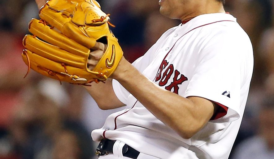 Boston Red Sox relief pitcher Koji Uehara reacts as he gives up an RBI double to Los Angeles Angels' Chris Iannetta in the ninth inning of a baseball game at Fenway Park in Boston, Tuesday, Aug. 19, 2014. The double proved to be the game winning hit as the Angels won 4-3. (AP Photo/Elise Amendola)