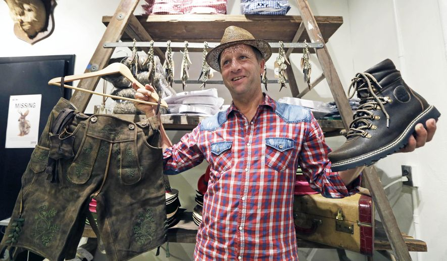 Michael Plangger, president of the German clothing store, Wiesnokoenig, poses inside his new flagship store, Wednesday, Aug. 20, 2014, located inside the Christian Moerlein Brewery in Cincinnati. (AP Photo/Al Behrman)