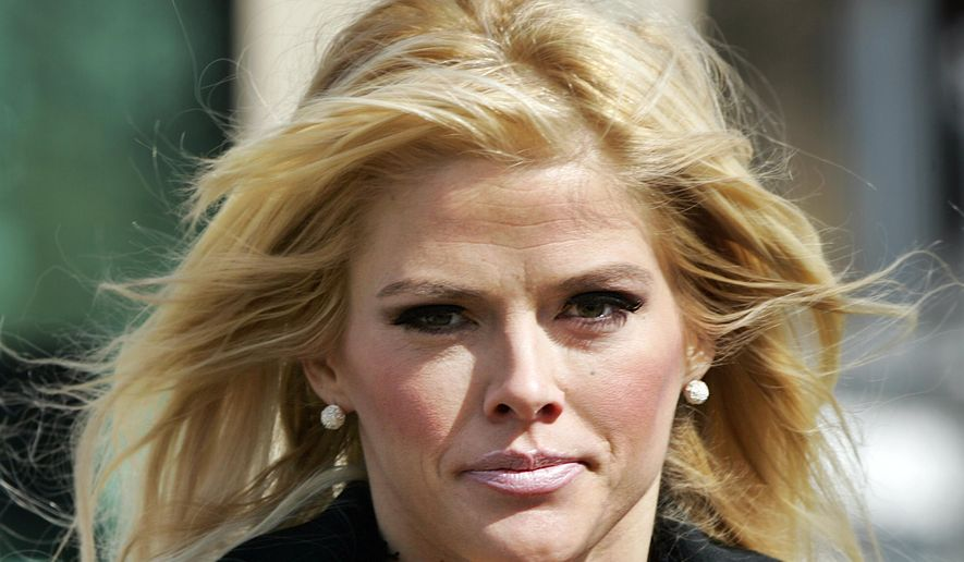 ** FILE ** In this Feb. 28, 2006, file photo, Anna Nicole Smith, leaves the U.S. Supreme Court in Washington, D.C. Smith's final bid to obtain her late husband's money has failed, seven years after her death. A federal judge in Santa Ana, Calif., on Monday, Aug. 18, 2014, rejected a bid by Smith's estate to obtain about $44 million from the estate of J. Howard Marshall II, her late Texas billionaire husband. (AP Photo/Manuel Balce Ceneta, File)