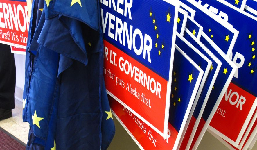 Campaign signs are stored inside the campaign headquarters of independent gubernatorial candidate, Bill Walker, in his downtown Anchorage, Alaska, campaign office, which held its grand opening Tuesday, Aug. 19, 2014 to coincide with Alaska's primary. Walker, 63, bypassed the primary, opting to gather signatures to qualify as an unaffiliated candidate for the November general election. (AP Photo/Rachel D'Oro)