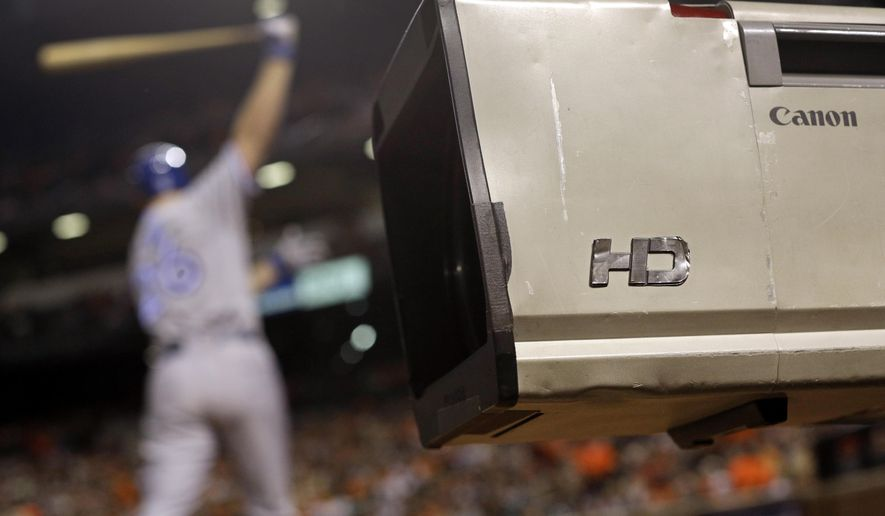 FILE - In this April 12, 2014 file photo, a television camera stands near the Toronto Blue Jays' on deck circle during a baseball game between the Blue Jays and the Baltimore Orioles, in Baltimore. Major League Baseball shows what can be done right when it comes to making its games available on the Internet. It also underscores frustrations fans have with online sports coverage in general: Television dominates and limits the Internet's potential. (AP Photo/Patrick Semansky, File)
