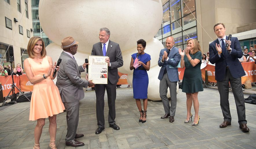 """This image released by NBC shows New York Mayor Bill de Blasio, third from left, presenting co-host Al Roker, second left, with a proclamation declaring it Al Roker Appreciation Day during a broadcast of the """"Today"""" show on Wednesday, Aug. 20, 2014,  in New York. Joining the mayor and Roker are co-hosts Natalie Morales, left, Tamron Hall, center, Matt Lauer, third right, Meredith Vieira, and Willie Geist, right. Roker turned 60 on Wednesday. (AP Photo/NBC, Michael Loccisano)"""