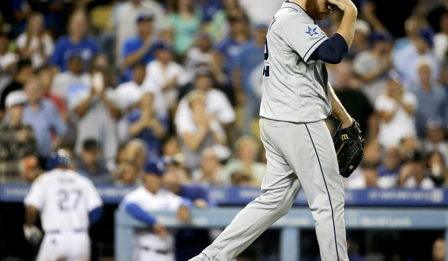 San Diego Padres starting pitcher Ian Kennedy, right, walks to the mound after Los Angeles Dodgers' Matt Kemp scores during the fifth inning of a baseball game in Los Angeles, Tuesday, Aug. 19, 2014. (AP Photo/Chris Carlson)