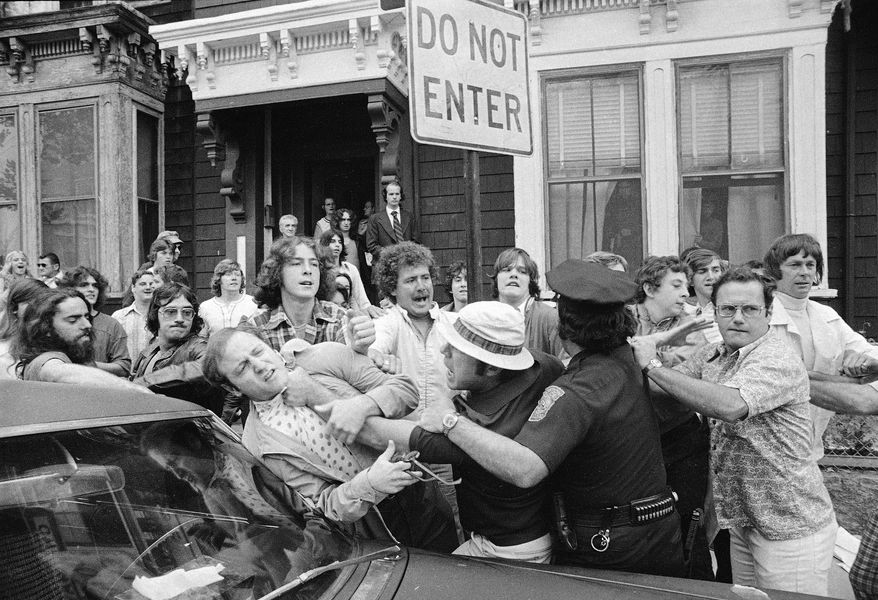 Police officers break up a scuffle amid demonstrators outside South Boston High School on the first day of a court-ordered busing program to integrate Boston public schools, Sept. 12, 1974.  South Boston High is predominantly white.  (AP Photo/Peter Bregg)