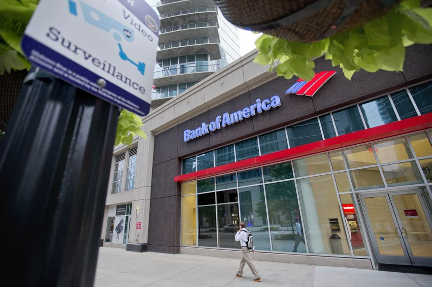 FILE - This July 16, 2013, file photo shows a Bank of America branch on Peachtree Street,  in Atlanta. How much will Bank of America's expected $17 billion mortgage settlement cost the company? The answer is, almost certainly not $17 billion. In mega-settlements negotiated with the U.S. government, a dollar is rarely worth an actual dollar. Inflated figures make sensational headlines for the Justice Department, and $17 billion would be the largest settlement by far arising from the economic meltdown in which millions of Americans lost their homes to foreclosure. But the true cost to companies is often obscured by opaque accounting techniques. (AP Photo/David Goldman, File)