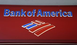 FILE - This, Oct. 14, 2012,  file photo shows a Bank of  America branch in downtown Miami. How much will Bank of America's expected $17 billion mortgage settlement cost the company? The answer is, almost certainly not $17 billion. In mega-settlements negotiated with the U.S. government, a dollar is rarely worth an actual dollar. Inflated figures make sensational headlines for the Justice Department, and $17 billion would be the largest settlement by far arising from the economic meltdown in which millions of Americans lost their homes to foreclosure. But the true cost to companies is often obscured by opaque accounting techniques. (AP Photo/Lynne Sladky, File )