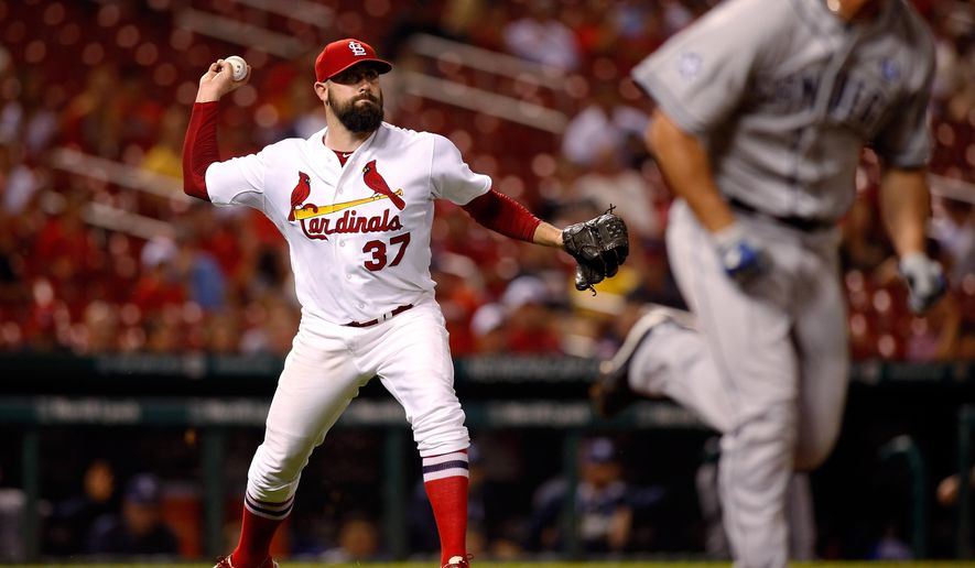 St. Louis Cardinals relief pitcher Pat Neshek throws to first for an out against San Diego Padres' Jake Goebbert during the ninth inning of a baseball game Friday, Aug. 15, 2014, in St. Louis. (AP Photo/Scott Kane)