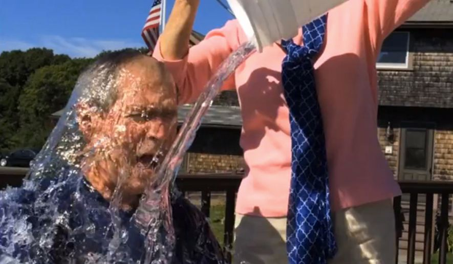 In this image from video posted on Facebook, courtesy of the George W. Bush Presidential Center, former President George W. Bush participates in the ice bucket challenge with the help of his wife, Laura Bush, in Kennebunkport, Maine. The challenge has caught on with notable figures participating in the campaign to raise money for the fight against ALS, or Lou Gehrig's disease. (AP Photo/Courtesy George W. Bush Presidential Center)
