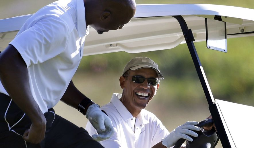CORRECTS DATE - President Barack Obama, right, smiles as he and former NBA basketball player Alonzo Mourning, left, prepare to ride in a golf cart while golfing at Vineyard Golf Club in Edgartown, Mass., on the island of Martha's Vineyard, Wednesday, Aug. 20, 2014. Obama is taking a two-week summer vacation on the island. (AP Photo/Steven Senne)