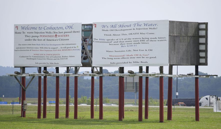 """This photo taken on Sunday, Aug. 17, 2014, and provided by Robert A. Franco, shows a billboard in Coshocton, Ohio opposing deep-injection wells . Michael Boals, an Ohio man who uses a biblical reference and a statement against """"poisoned waters"""" on billboards opposing local deep-injection gas wells is fighting a legal threat from the Texas well owner on grounds he's exercising his free speech. (AP Photo/Robert A. Franco)"""