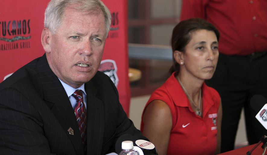 University of New Mexico athletic director Paul Krebs, left, discusses a hazing incident involving the women's soccer team as head coach Kit Vela sits beside him during a news conference in Albuquerque, N.M., on Wednesday, Aug. 20, 2014. Krebs said the hazing involved alcohol and the team is now undergoing a hazing education class and will have to perform community service. Officials said other sanctions are possible pending the completion of an investigation. (AP Photo/Susan Montoya Bryan)