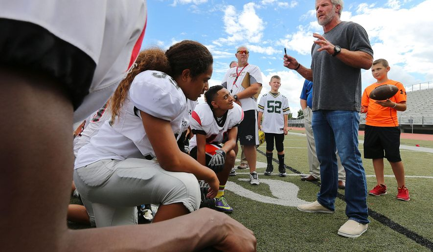 In this photo taken on Tuesday, Aug. 19, 2014, former NFL football player Brett Favre talks with the Alta High School football team in Sandy, Utah. (AP Photo/The Deseret News, Scott G Winterton)  SALT LAKE TRIBUNE OUT;  MAGS OUT