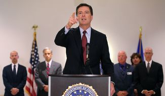 """FBI Director James Comey takes a question during a news conference at the FBI field office in Denver, Wednesday Aug. 20, 2014. FBI Director James Comey says Islamic State extremists who executed journalist James Foley are """"savages"""" and that the agency is helping investigate the killing.  (AP Photo/Brennan Linsley)"""