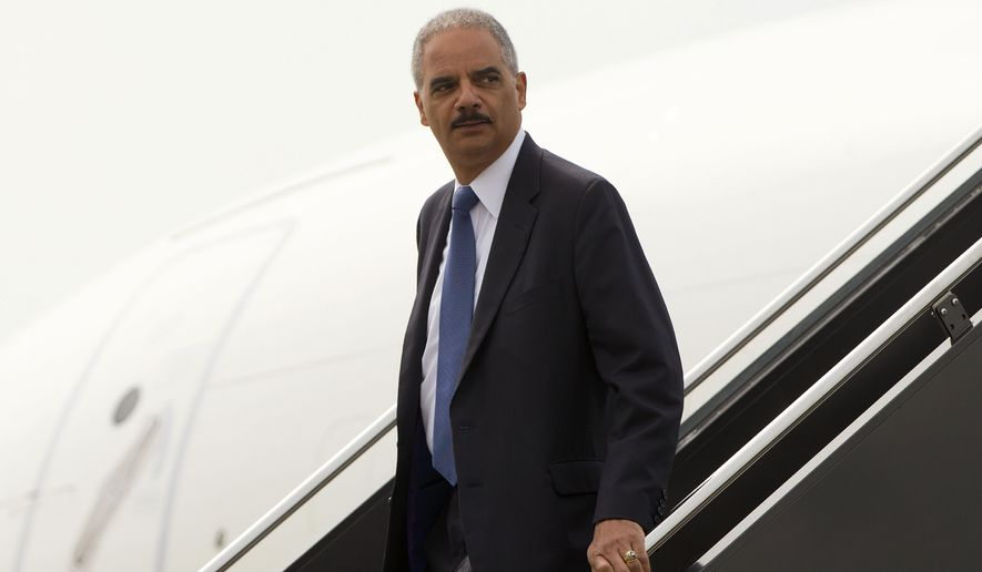 Attorney General Eric Holder arrives on US Military aircraft at Lambert-St. Louis International Airport in St. Louis, Wednesday, Aug. 20, 2014. Holder is traveling to Ferguson, Mo., to oversee the federal government's investigation into the shooting of 18-year-old Michael Brown by a police officer on Aug. 9th. (AP Photo/Pablo Martinez Monsivais/Pool)