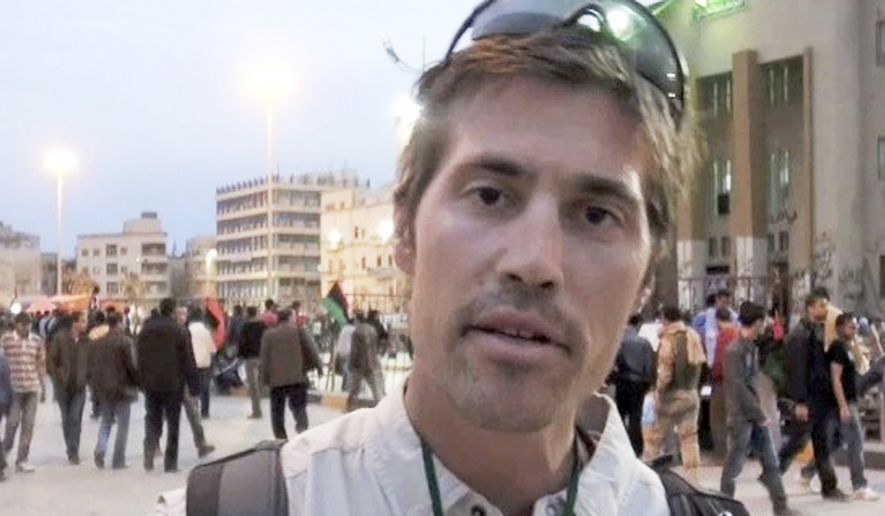 James Foley of Rochester, N.H., a freelance contributor for GlobalPost, in Benghazi, Libya. (AP Photo/GlobalPost, File)