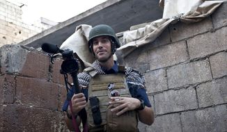 ** FILES ** This November 2012 file photo, posted on the website freejamesfoley.org, shows American journalist James Foley while covering the civil war in Aleppo, Syria. In a horrifying act of revenge for U.S. airstrikes in northern Iraq, militants with the Islamic State extremist group have beheaded Foley and are threatening to kill another hostage, U.S. officials say. (AP Photo/freejamesfoley.org, Nicole Tung, File)