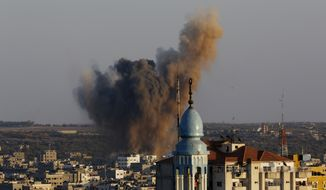 Smoke, dust and debris rise after an Israeli strike hit Gaza City in the northern Gaza Strip, Wednesday, Aug. 20, 2014. (AP Photo/Adel Hana)