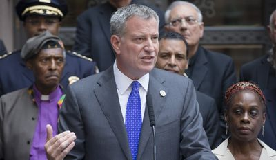 ** FILE ** New York City Mayor Bill de Blasio speaks at a press conference alongside first lady Chirlane McCray, right,  following a multifaith roundtable meeting Wednesday, Aug. 20, 2014, in New York, spawned by the death of Eric Garner, a Staten Island man who was placed in an apparent chokehold by a police officer, The mayor says he believes the meeting can help a city gripped by protests and distrust of the police in some minority neighborhoods. (AP Photo/John Minchillo)