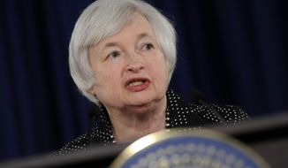 FILE - In this June 18, 2014 file photo, Federal Reserve Chair Janet Yellen speaks during a news conference at the Federal Reserve in Washington. Yellen has won credit for guiding the Federal Reserve's first six months of transition from the Ben Bernanke era. (AP Photo/Susan Walsh, File)