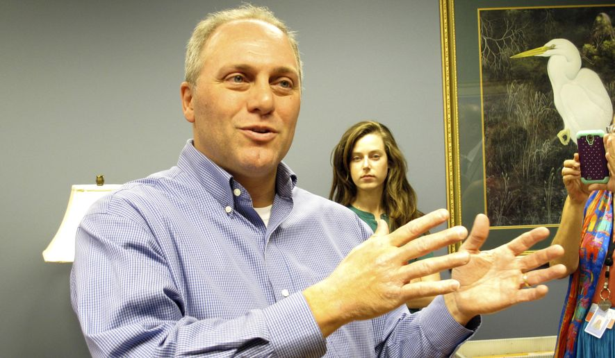 Republican U.S. Rep. Steve Scalise, the No. 3 ranking House member, speaks with elections officials as he signs up to run for re-election on Thursday, Aug. 21, 2014, in Baton Rouge, La. (AP Photo/Melinda Deslatte) **FILE**
