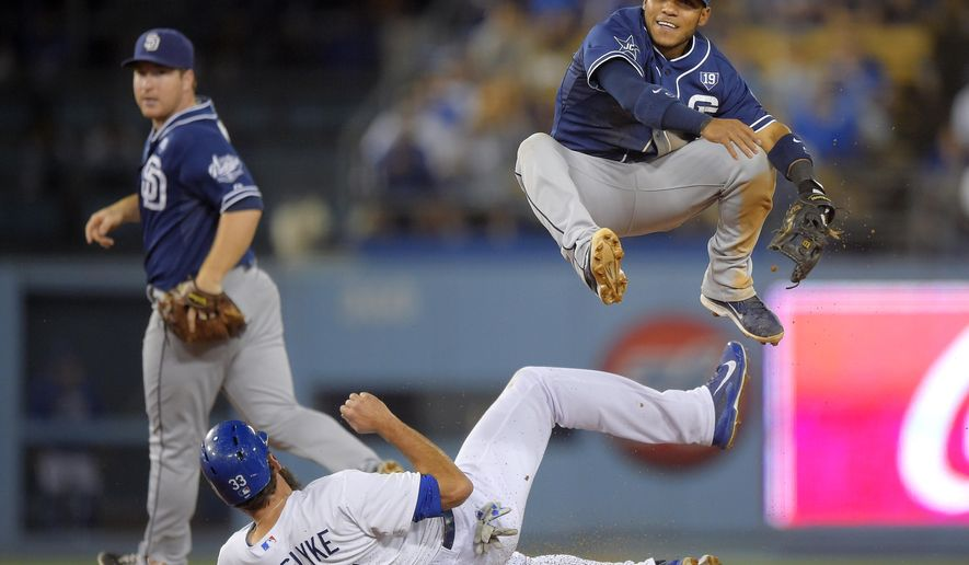 Los Angeles Dodgers' Scott Van Slyke, center, is forced out at second as San Diego Padres shortstop Alexi Amarista, right, makes a late throw to first in an attempt to get Carl Crawford, while second baseman Jedd Gyorko watches during the ninth inning of a baseball game, Wednesday, Aug. 20, 2014, in Los Angeles. The Padres wpm 4-1. (AP Photo/Mark J. Terrill)
