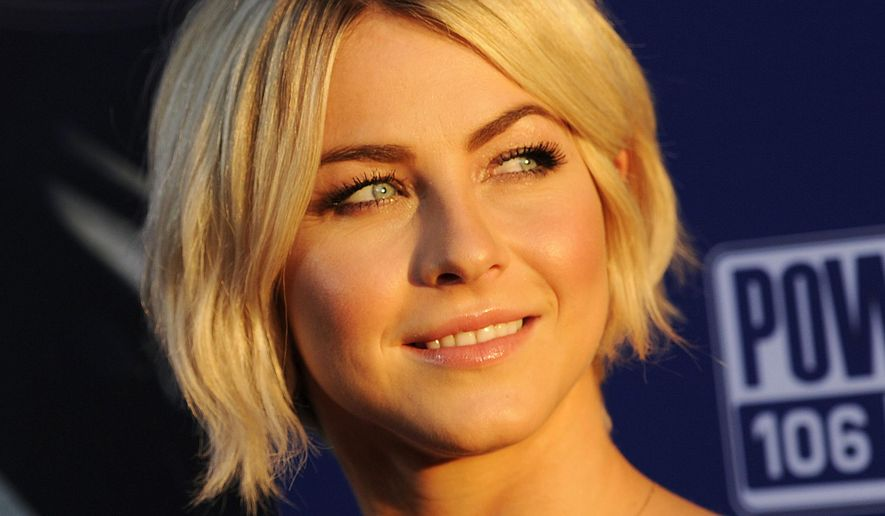 """FILE - In this Thursday, Aug. 7, 2014, file photo, actress Julianne Hough looks back for photographers at the premiere of the film """"Let's Be Cops,"""" in Los Angeles. """"Dancing With the Stars"""" says two-time champion Hough is returning to the ballroom as a judge this season. She will preside alongside Len Goodman, Carrie Ann Inaba and Bruno Tonioli. The new season launches Sept. 15 on ABC. (Photo by Chris PizzelloInvision/AP, File)"""