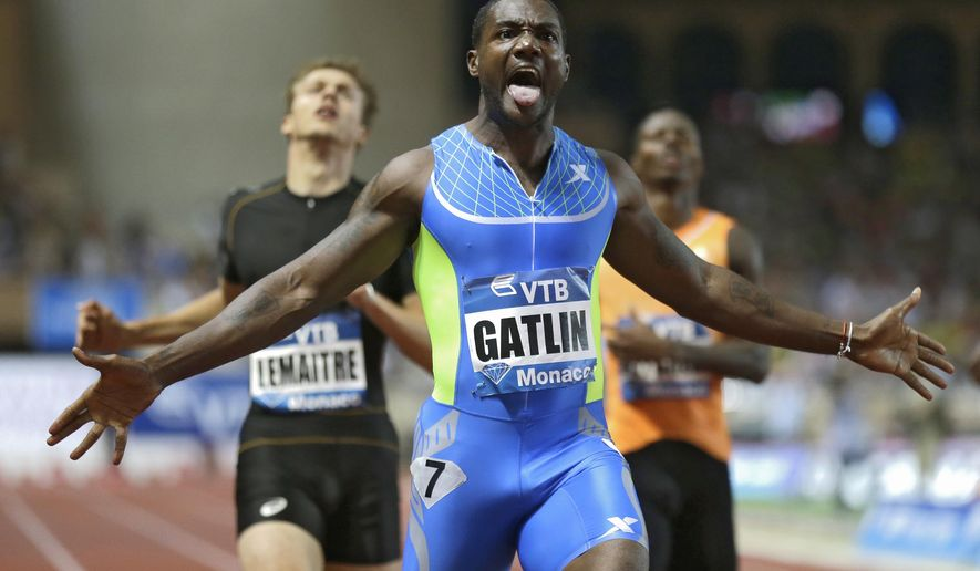 FILE - In this July 18, 2014, file photo, Justin Gatlin, of the United States, wins the men's 200 meters during the Herculis International Athletics Meeting, at the Louis II Stadium, in Monaco. No matter how fast Justin Gatlin runs, the American sprinter can't seem to distance himself from his checkered past. Gatlin's four years removed from serving his four-year doping suspension and there are meets that still refuse to include him. (AP Photo/Lionel Cironneau, File)
