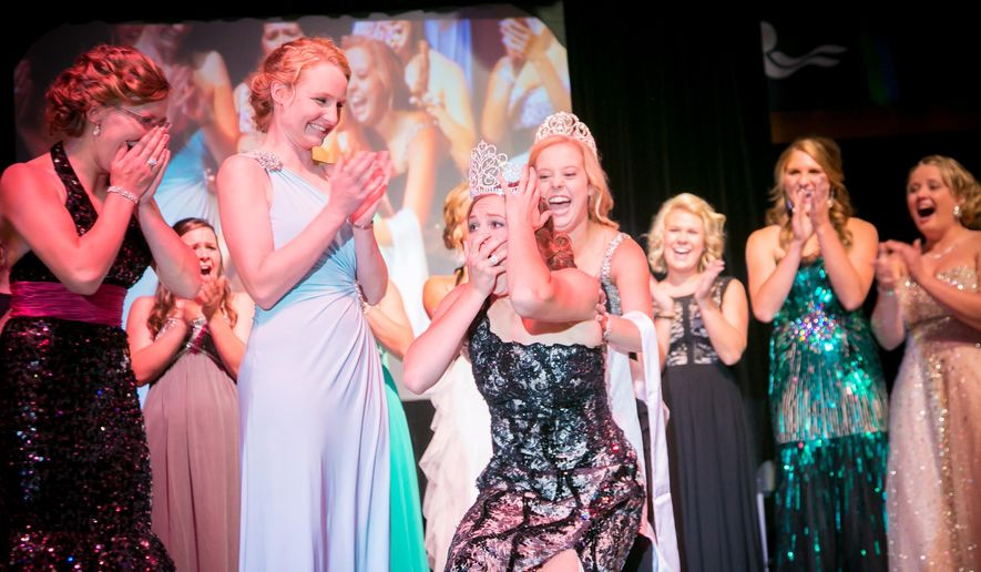 In this photo provided by the Midwest Dairy Association, Jeni Haler, 19, center, reacts as she is named 61st Princess Kay of the Milky Way during a ceremony at the Minnesota State Fairgrounds in St. Paul, Minn. on Wednesday, Aug. 20, 2014. (AP Photo/Midwest Dairy Association, Matt Addington)