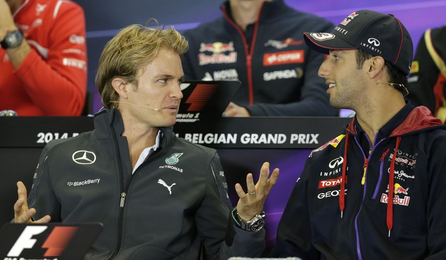Red Bull driver Daniel Ricciardo of Australia, right, talks with Mercedes driver Nico Rosberg of Germany during a media conference ahead of Sunday's Belgian Formula One Grand Prix in Spa-Francorchamps, Belgium, Thursday, Aug. 21, 2014. (AP Photo/Yves Logghe)