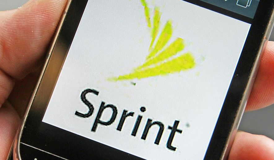 In this Monday, July 29, 2013, photo, a Sprint logo is displayed on a smart phone in Montpelier, Vt. In revamping its prices and plans this week, Sprint is joining Verizon and AT&T in letting families share pools of data. (AP Photo/Toby Talbot, File)