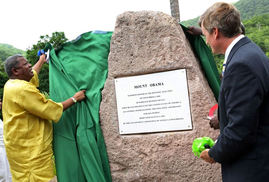 "Prime Minister Baldwin Spencer of Antigua and Barbuda (left), unveils a stone during a ceremony naming Antigua's highest mountain ""Mount Obama."" The president's name has also been lent in rechristenings at other places around the globe. (Associated Press)"