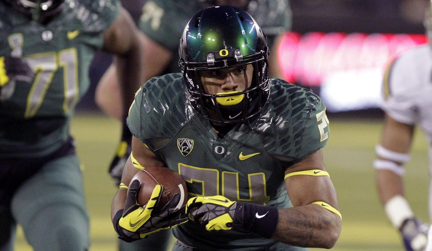 FILE - In this Oct. 26, 2013, file photo, Oregon running back Thomas Tyner carries the ball during the first half of an NCAA college football game against UCLA in Eugene, Ore. Tyner is ready to live up to the expectations that were heaped on him when he joined the Ducks. He was third on the Ducks with 711 yards rushing last year, and he scored nine touchdowns. (AP Photo/Don Ryan, File)
