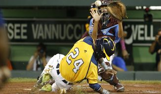 Chicago's Trey Hondras (24) scores the second of two runs on a throwing error by Philadelphia catcher Scott Bandura, top, who takes the late relay throw from right field during the second inning of an elimination baseball game at the Little League World Series tournament in South Williamsport, Pa., Thursday, Aug. 21, 2014. (AP Photo/Gene J. Puskar)