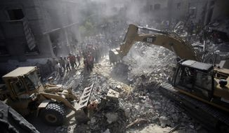 Palestinians gather around the rubble of a destroyed house following Israeli strikes in the Rafah refugee camp, Southern Gaza Strip, Thursday, Aug. 21, 2014. (AP Photo/Khalil Hamra)