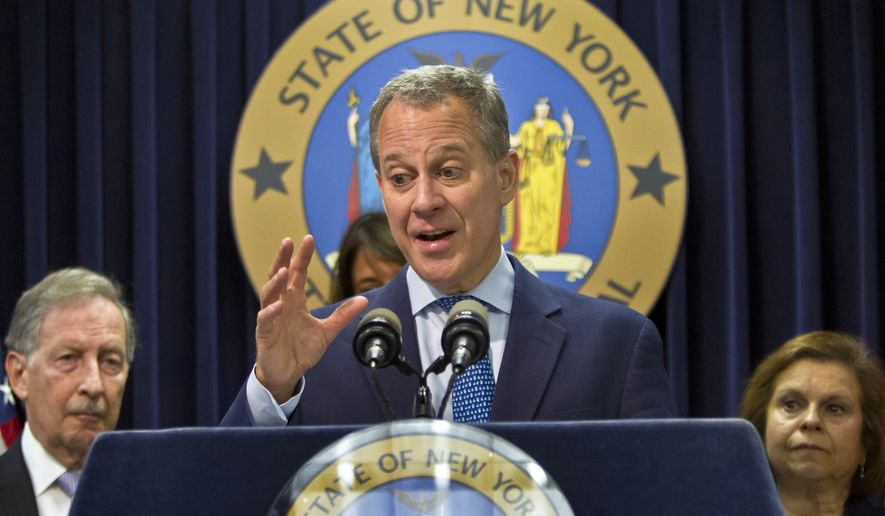 New York Attorney General Eric Schneiderman, center, speaks during a news conference, Thursday, Aug. 21, 2014 in New York. New York state will get $800 million as its share of a national $16.65 billion settlement with Bank of America over its role in the sale of mortgage-backed securities in the run-up to the financial crisis. (AP Photo/Bebeto Matthews)