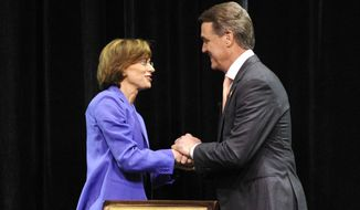 U.S. Senate candidates, Democrat Michelle Nunn, left, and Republican David Perdue, shake hands before their televised candidates forum Thursday, Aug. 21, 2014, in Macon, Ga. The Georgia race is one of the most closely watched this year as Republicans make a push to take control of the Senate for the last two years of Obama's term. (AP Photo/The Macon Telegraph, Woody Marshall)