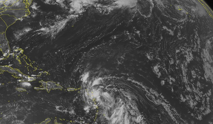 This NOAA satellite image taken Thursday, August 21, 2014 at 01:45 PM EDT shows an area of disorganized clouds moving across the Lesser Antilles associated with a possible developing tropical system. Scattered clouds with rain and thunderstorms is present across portions of the Bahamas and eastern Cuba. Widely scattered clouds are located across the Caribbean Basin. (AP PHOTO/WEATHER UNDERGROUND)