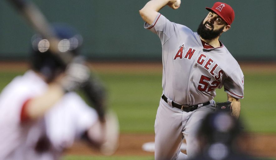 Los Angeles Angels starting pitcher Matt Shoemaker delivers to the Boston Red Sox during the first inning of a baseball game at Fenway Park in Boston, Thursday, Aug. 21, 2014. (AP Photo/Charles Krupa)