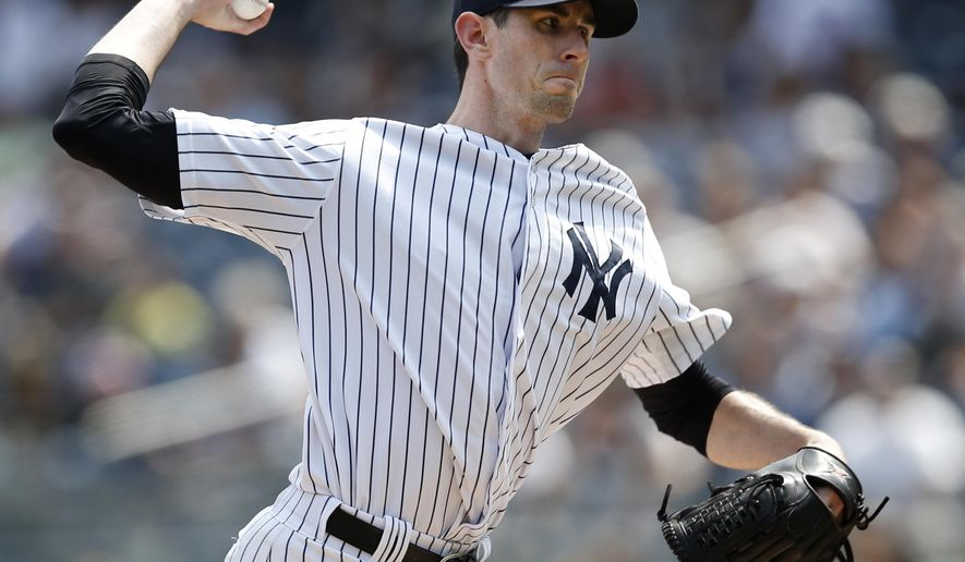 New York Yankees starting pitcher Brandon McCarthy delivers in the first inning of a baseball game against the Houston Astros at Yankee Stadium in New York, Thursday, Aug. 21, 2014.  (AP Photo/Kathy Willens)