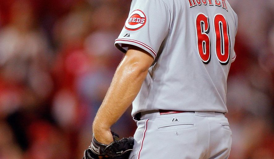 Cincinnati Reds relief pitcher J.J. Hoover  stands on the mound after walking St. Louis Cardinals' Jhonny Peralta to load the bases during the ninth inning of a baseball game Tuesday, Aug. 19, 2014, in St. Louis. (AP Photo/Scott Kane)