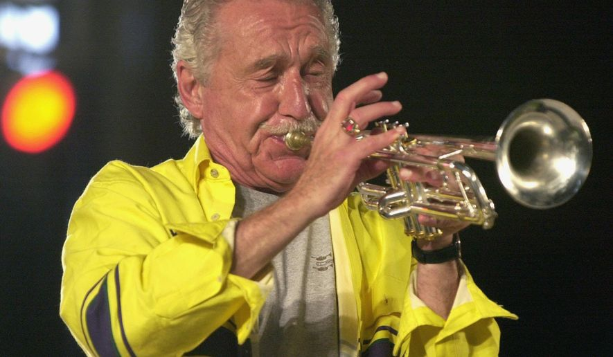 FILE - This Oct. 9, 2001 file photo, shows Doc Severinsen practicing for a performance in Hattiesburg, Miss. Severinsen is among three people being inducted into the Scandinavian-American Hall of Fame in Minot, N.D., in 2014. The Grammy Award-winning Severinsen was leader of The Tonight Show Band for 30 years, during the heyday of Johnny Carson and Ed McMahon. (AP Photo/Hattiesburg American, George Clark, File)