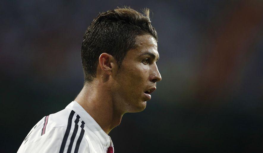 Real Madrid's Cristiano Ronaldo reacts during a Spanish Super Cup soccer match against Atletico Madrid at Santiago Bernabeu stadium in Madrid, Spain, Tuesday, Aug. 19, 2014 . (AP Photo/Daniel Ochoa de Olza)